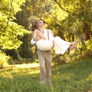 groom-carries-bride