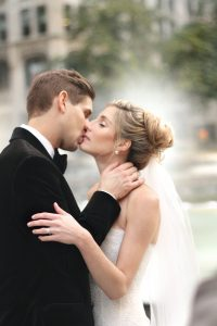 a-kissing-by-fountain