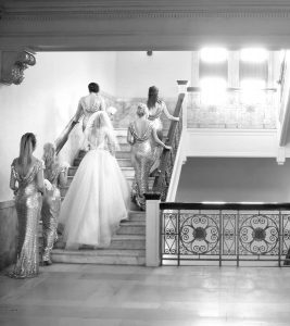 bridesmaids-going-up-stairs-s