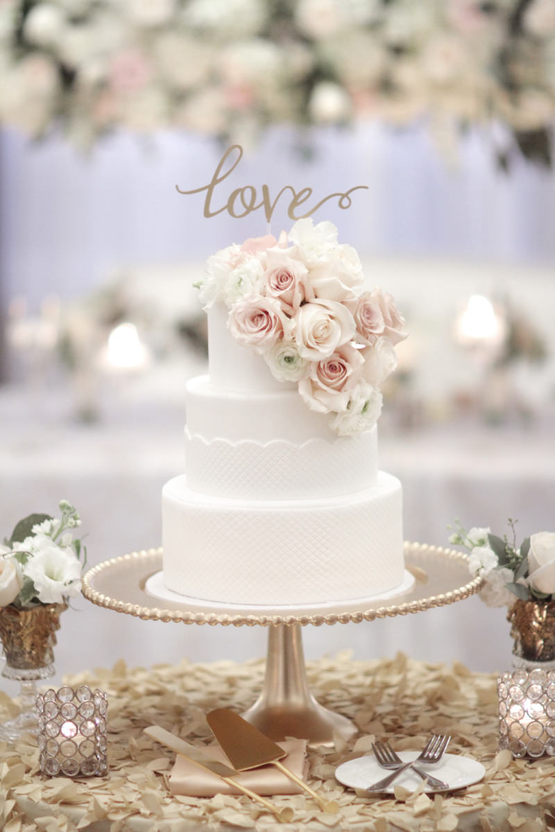 gorgeous wedding cake with a LOVE cake topper
