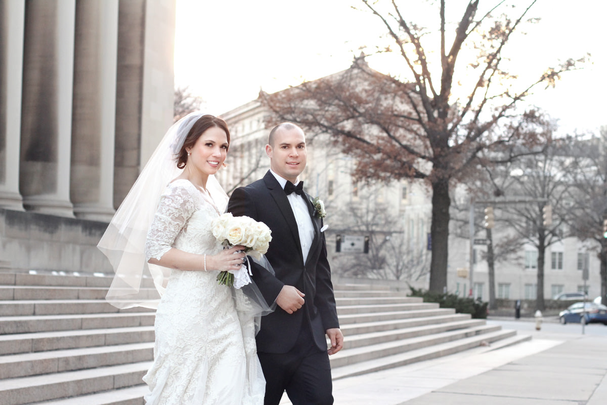 newlyweds walking together at carnegie institute in pittsburgh, pa