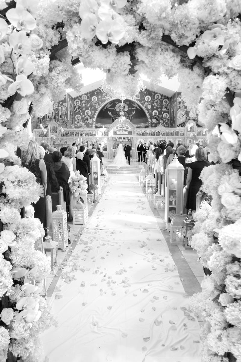 gorgeous flower arch leading into pittsburgh greek wedding ceremony