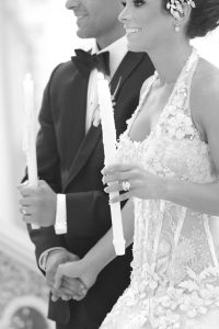 couple holding greek wedding candles in pittsburgh, pa ceremony
