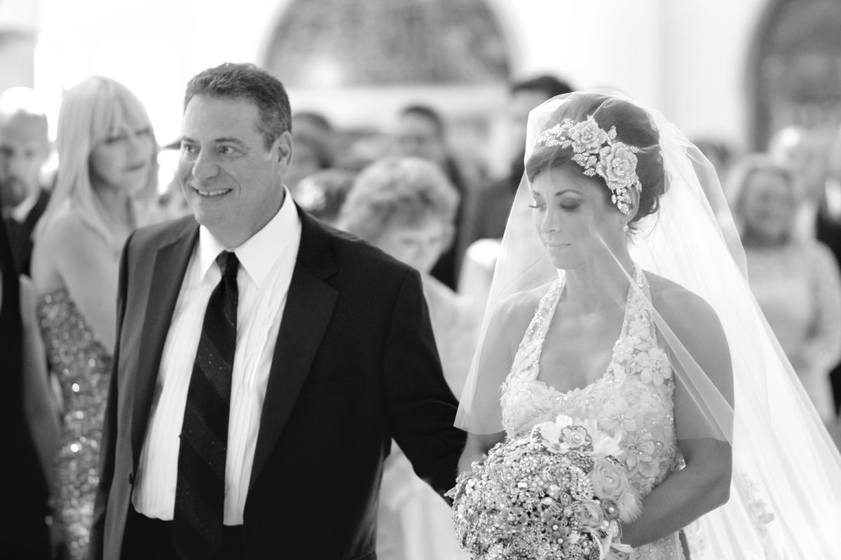 father walks bride down aisle at all saints greek orthodox church in pittsburgh, pa