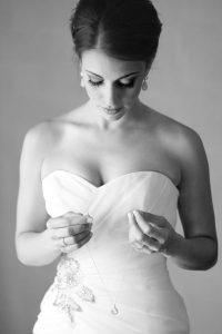 bride looking at her necklace