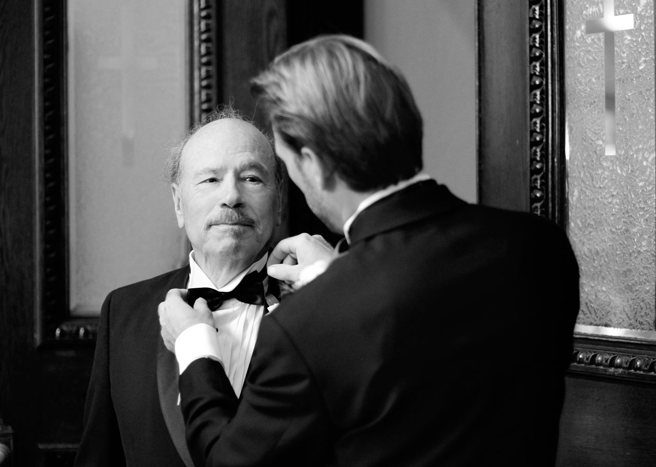 groom fixing dad's tie
