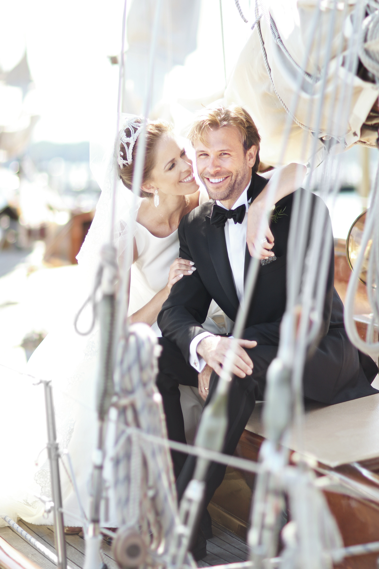 newlyweds on sailboat