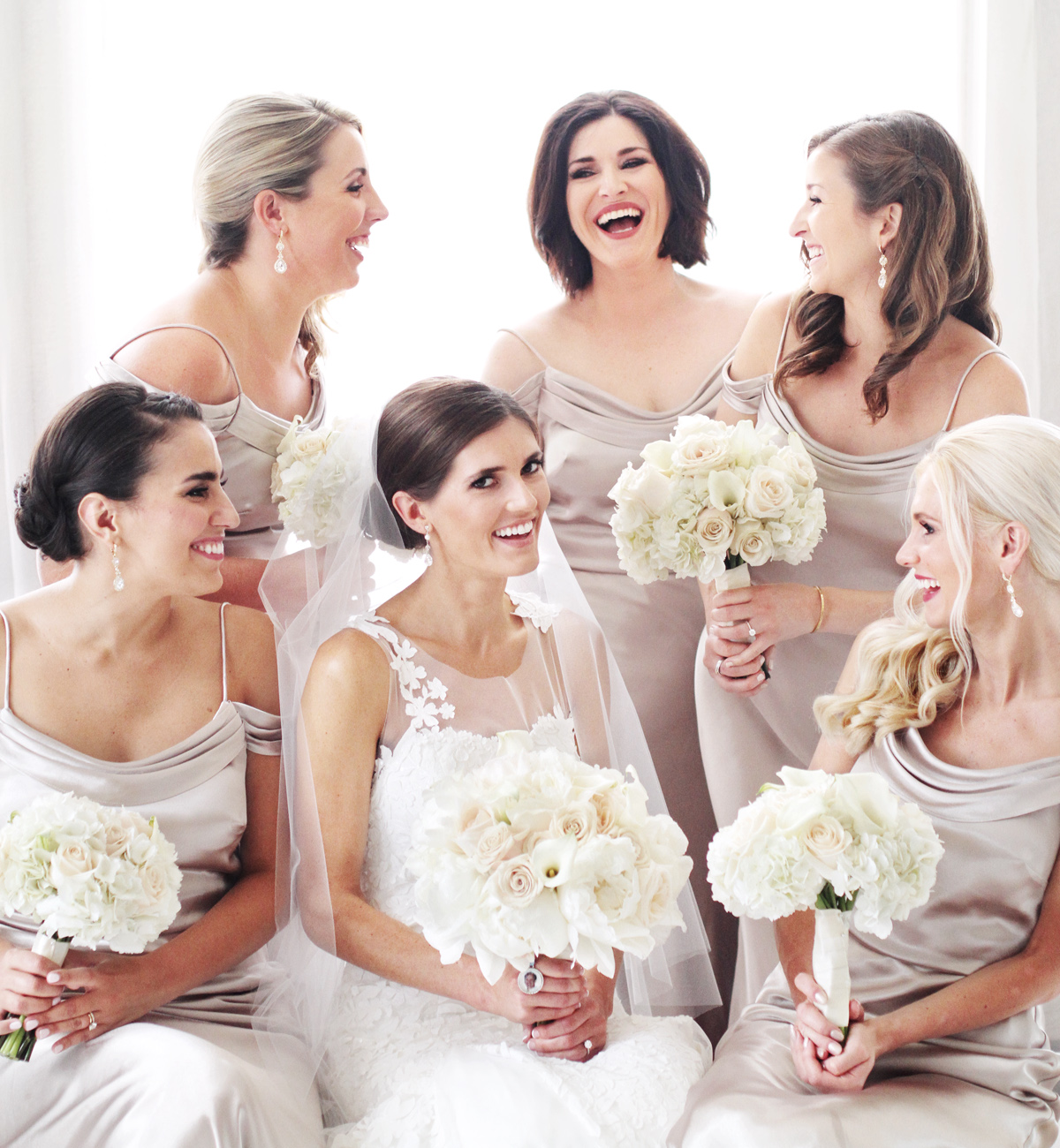 bridesmaids laughing together