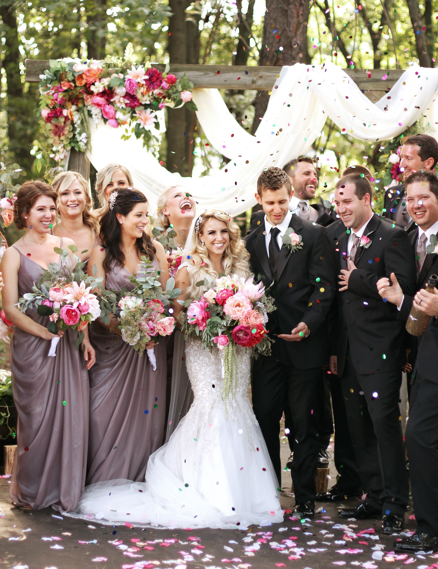 A wedding party celebration picture with confetti