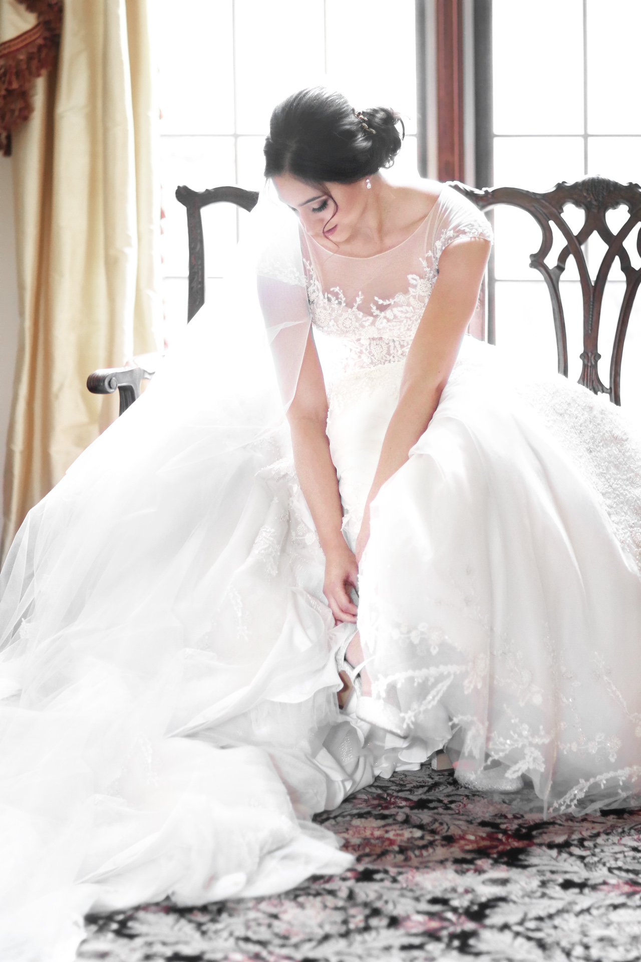 bridal putting on wedding shoes