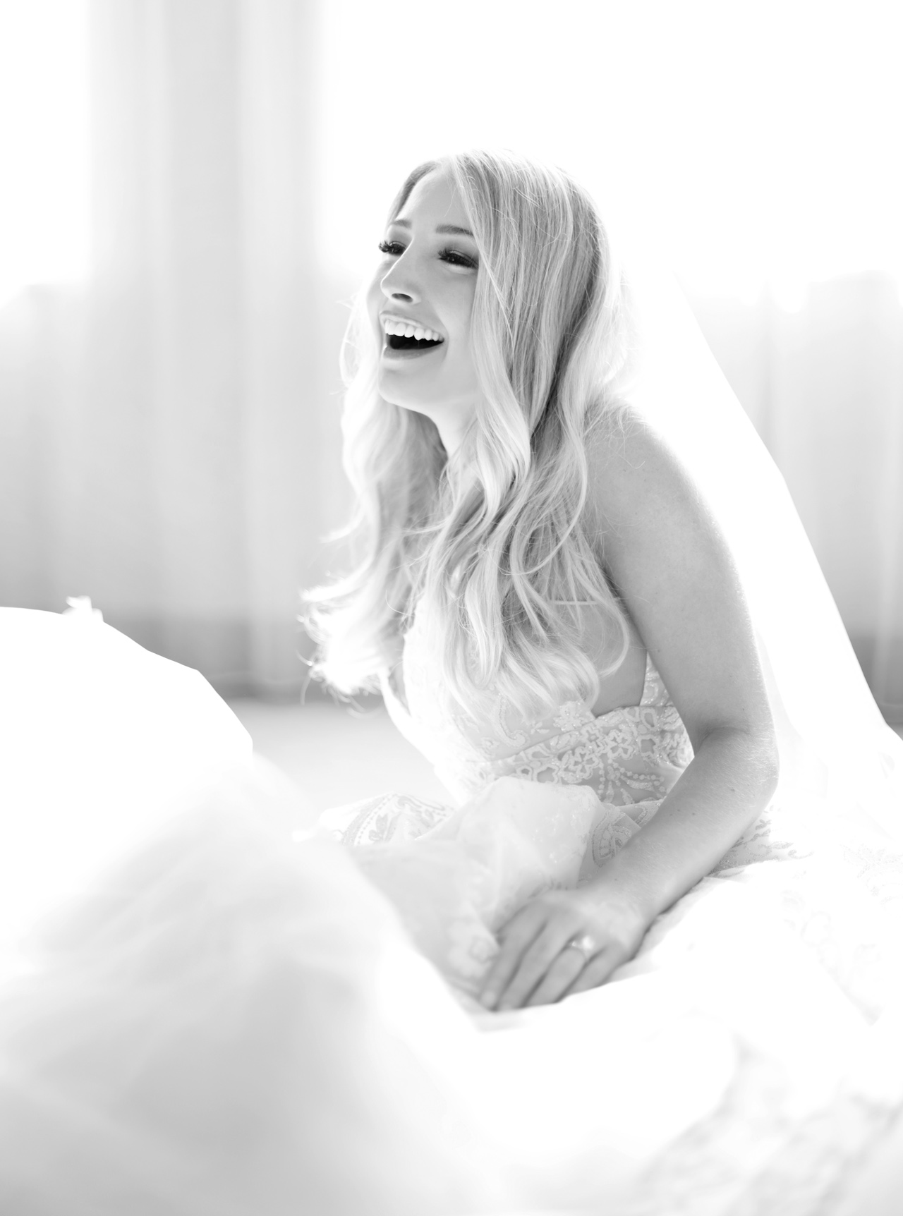 beautiful laughing bride in pittsburgh by araujo photography