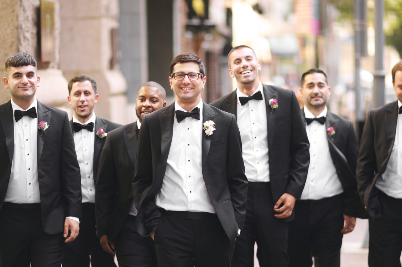 groomsmen walking in downtown Pittsburgh, PA