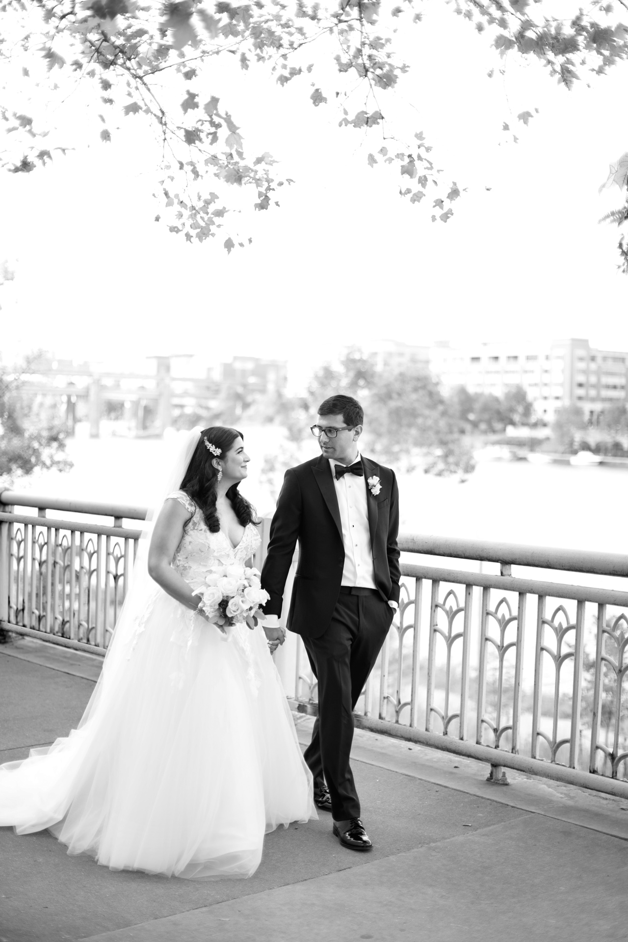 bride and groom walking along the Allegheny River