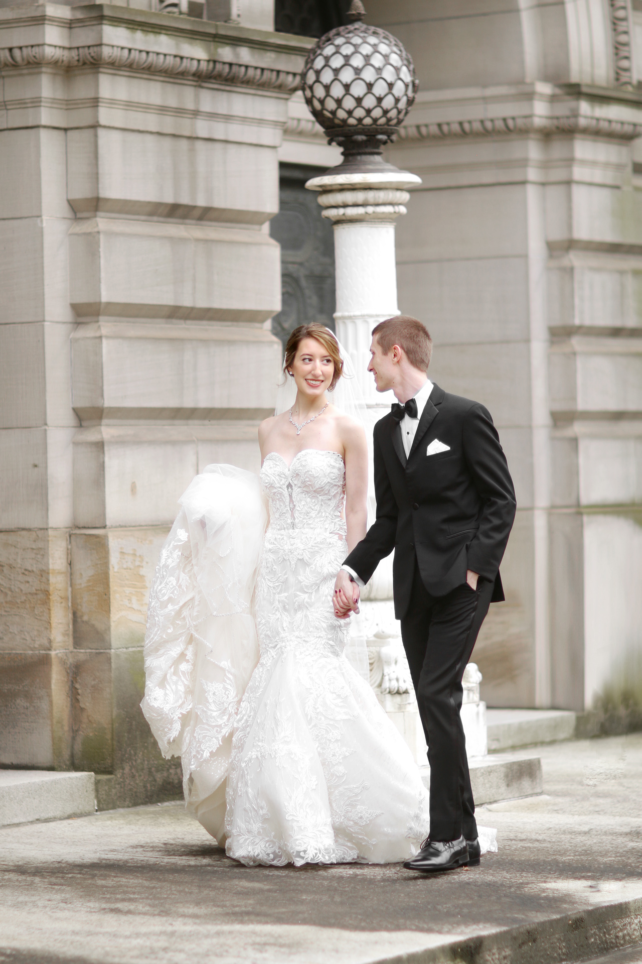 bride and groom walking at carnegie museum