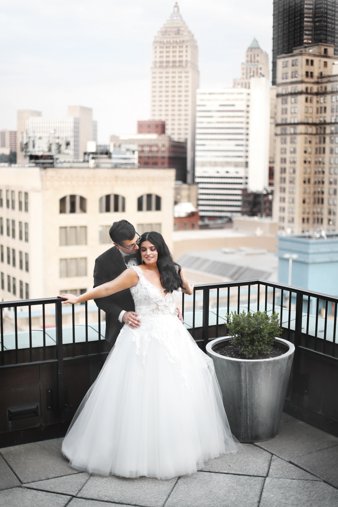bride and groom on the terrace overlooking downtown Pittsburgh, PA at the Renaissance Hotel