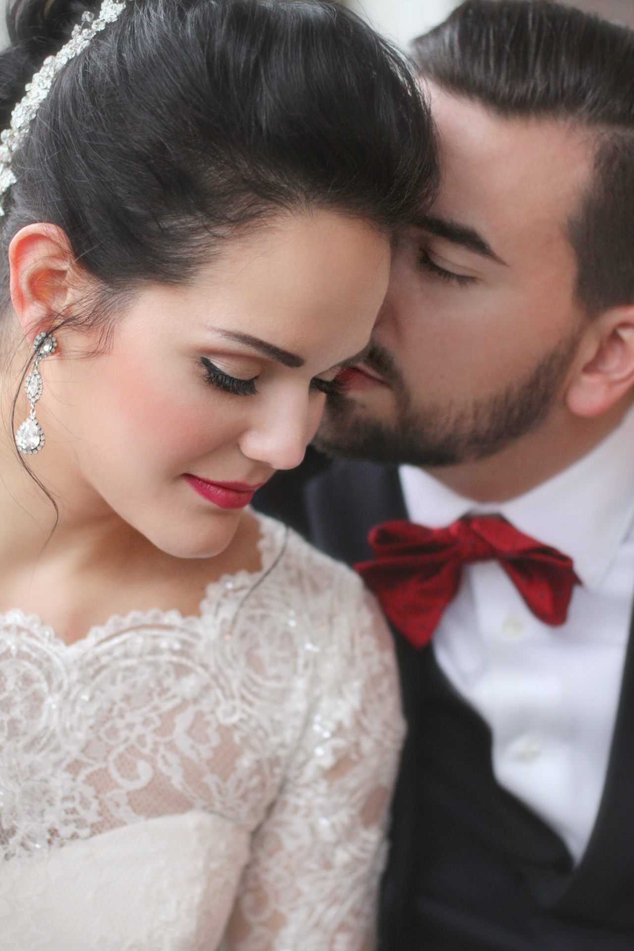pretty bride and groom with red bowtie