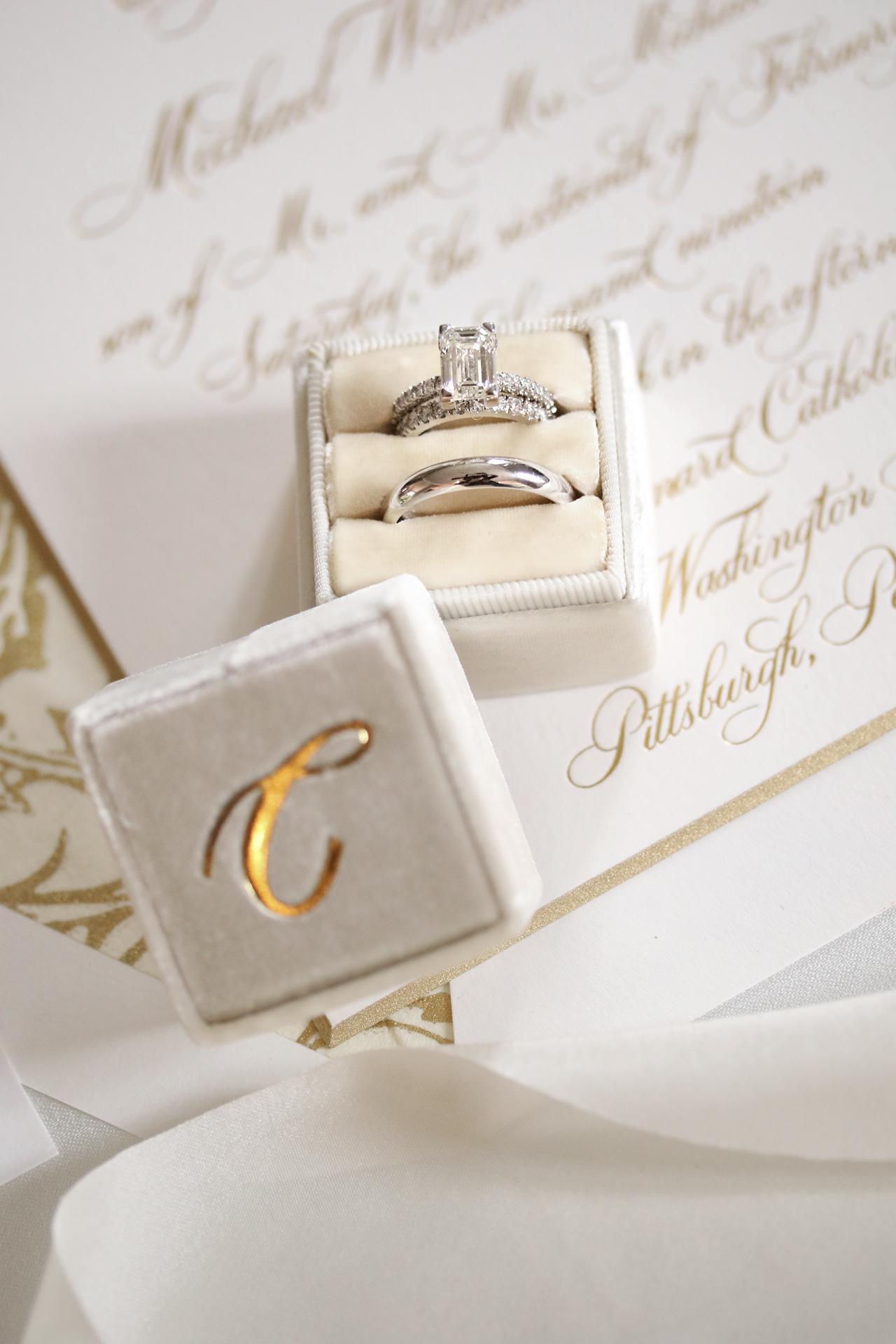 wedding rings sitting on an invitation