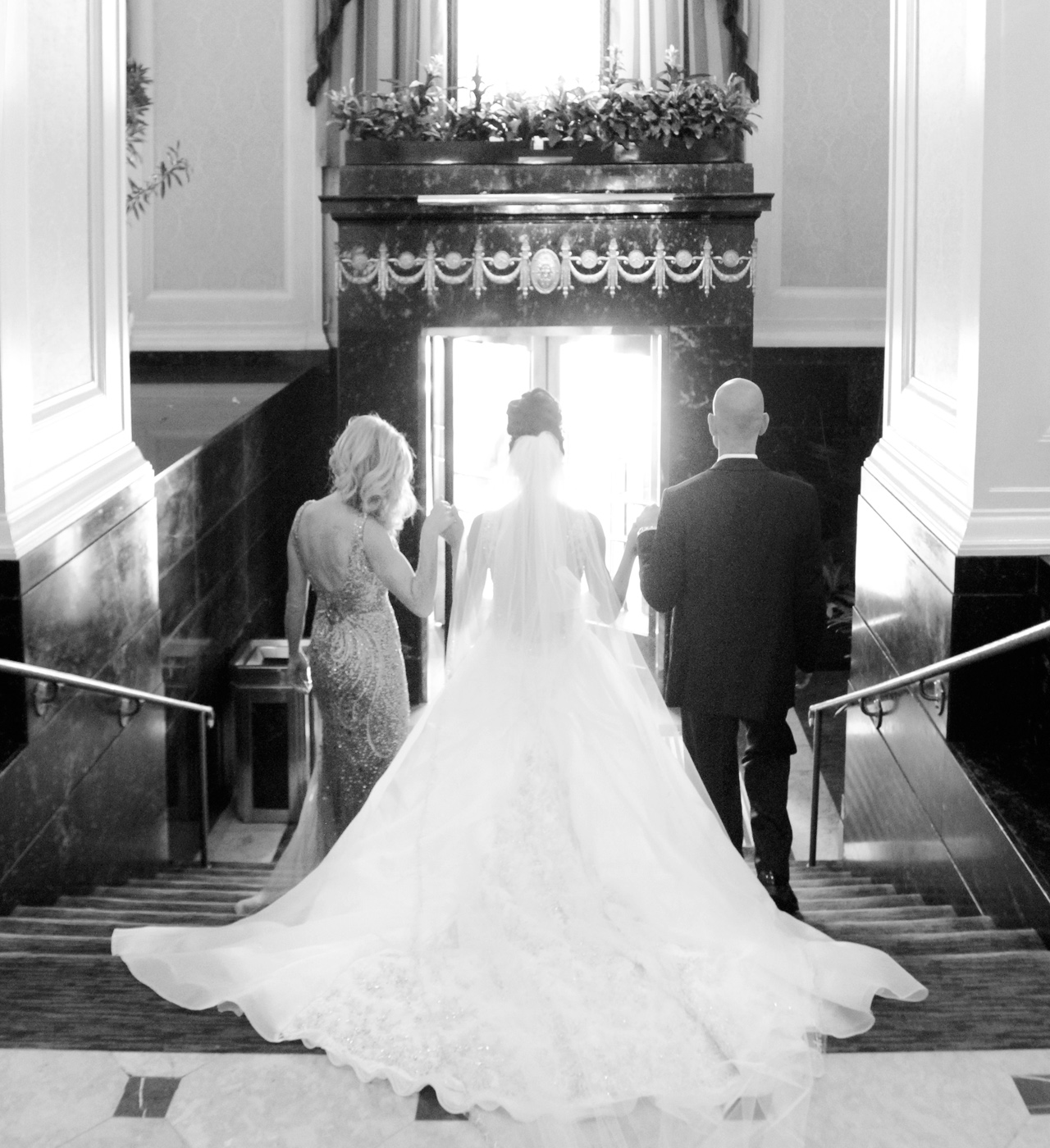 parents walking bride down stairs in pittsburgh pa wedding